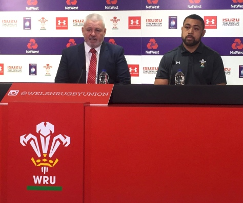 An impassive Toby Felatau (right) listens to his coach Warren Gatland talk about the Italy game.